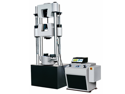 A hydraulically operated universal testing machine along with a power-pack and an electronic control panel.
