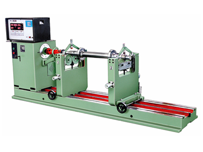 A horizontal balancing machine with direct drives through the control unit over the pedestals sliding over guide rails.